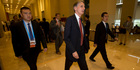 Britain's Chancellor of the Exchequer Philip Hammond, centre, walks to a meeting during the G20 Finance Ministers and Central Bank Governors conference held in Chengdu. Photo / AP