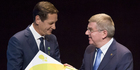 Russian Olympic Committee head Alexander Zhukov, left, receives the official invitation for the 2016 Olympic games from the IOC President Thomas Bach. Photo / AP