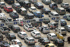 People sit and wait with their cars, having reached near to the front of the queue at the Port of Dover. Photo / AP