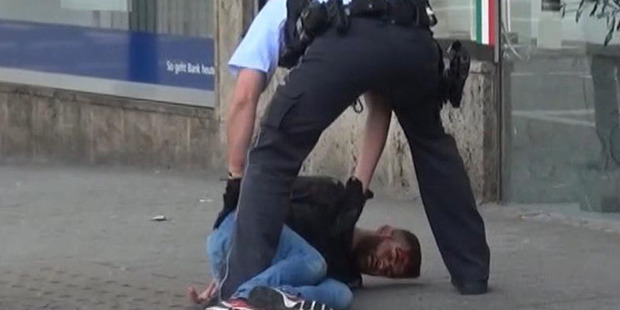In this grab taken from video, police arrest a man in Reutilingen, Germany. Photo / AP