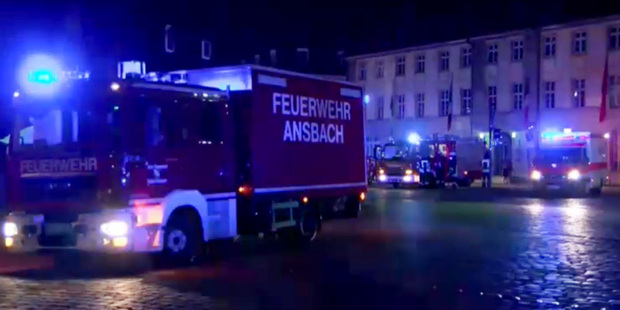 Emergency services in the city center of Ansbach after a man was killed when an explosive device he was believed to be carrying went off. Photo / AP