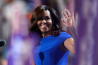 First Lady Michelle Obama takes the stage during the first day of the Democratic National Convention. Photo / AP