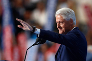 Former President Bill Clinton waves as he takes to the podium during the second day of the Democratic National Convention in Philadelphia. Photo / AP