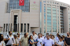 Journalist gather outside court to support their colleague journalist Bulent Mumay, who was detained in connection with the investigation launched into the failed coup attempt. Photo / AP