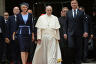 Pope Francis flanked by Polish President Andrzej Duda, right, and his wife Agata Kornhauser-Duda arrives for an official welcoming ceremony at the royal Wawel Castle in Krakow, Poland. Photo / AP