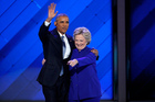 President Barack Obama and Democratic presidential nominee Hillary Clinton wave to delegates after she joined President Obama on stage. Photo / Getty Images