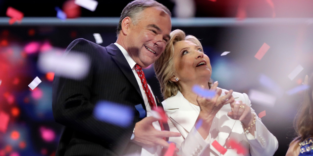 Loading US Democratic presidential candidate Hillary Clinton is joined by running mate Senator Tim Kaine after her speech during the final day of the Democratic National Convention. Photo/AP