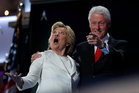 Hillary Clinton and husband Bill acknowledge the crowd at the Democratic National Convention in Philadelphia yesterday. Photo / AP