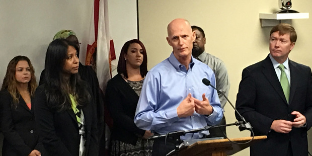 Florida Gov. Rick Scott speaks at a news conference in Florida where he announced that the state likely has the first cases of Zika transmitted by mosquitoes on the US. Photo / AP
