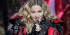 After the Orlando massacre in a nightclub, Madonna reached out to show that her heart was deeply entrenched in gay culture - by uploading a photo of her kissing Britney Spears. Photo / AP
