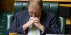PERSONAL EXPERIENCE: Minister Nick Smith really wishes he hadn't drunk that paint stripper.
