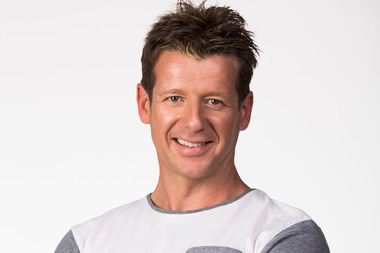 Radio host Simon Barnett pulled an injured woman from the wreckage of a car which had crashed in front of him and his family. Photo / Supplied