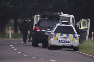 Armed police stand guard during the Kawerau as the siege. Photo / Nick Reed