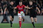 New Zealand All Blacks 1st-five Aaron Cruden and Beauden Barrett compete for the ball with Wales centre Jonathan Davies. Photo / Getty Images.