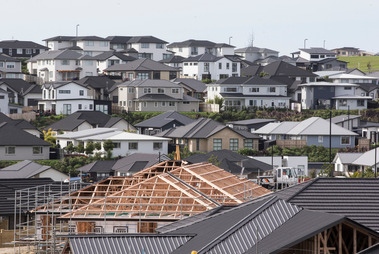 Infometrics predicts a national decline in house prices of 14 per cent in real terms by mid-2020. Photo / Greg Bowker