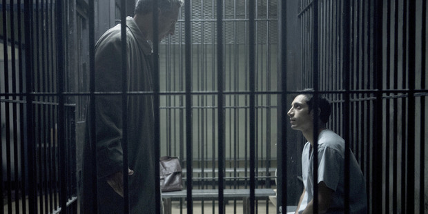 """""""Don't go anywhere,"""" attorney John Stone (John Turturro) tells Naz (Riz Ahmed) drily as he leaves him in his cell. Photo / HBO"""