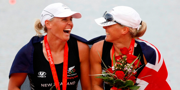 Georgina, left, and Caroline Evers-Swindell celebrate their first Olympic gold, after winning the double sculls in Beijing. Photo / Kenny Rodger