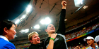 Adams and her coach Kirstin Hellier are elated as her shot put victory is sealed at Beijing's National Stadium on day eight of the 2008 Games. Photo / Kenny Rodger