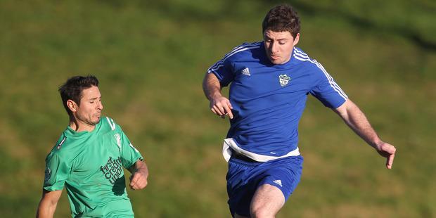 Otumoetai player Juan Pablo Rosende, left. Rotorua United (blue) vs Otumoetai, club football at Neil Hunt Park. 16 July 2016 Rotorua Daily Post Photograph by Ben Fraser.