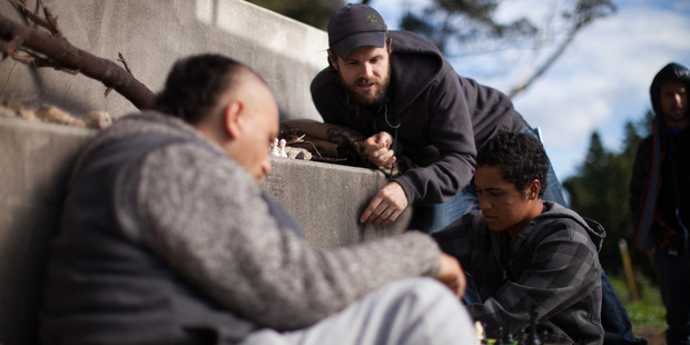 Cliff Curtis, left, and director James Napier Robertson and James Rolleston, right, on the set of The Dark Horse.  Photo / Supplied
