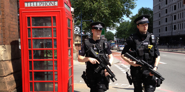 Armed Metropolitan Police patrol the street outside the St Pancras train station. Photo / File