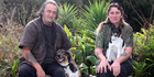 Pete Roy with Max and Angela Rose-Collins with  Roxy.