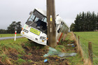 The Dannevirke school bus which was blown off Top Grass Rd into a power pole yesterday morning, with 14 primary school students on board. Photo / Christine McKay