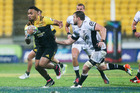 Willis Halaholo of the Hurricanes makes a break during the Super Rugby Quarterfinal match between the Hurricanes and the Sharks. Photo / Getty Images