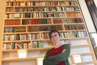 Browsers owner Rachel Pope stands below her new giant bookshelf