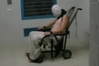 Horrific video has emerged of an Australian teenager strapped into a mechanical restraint chair, wearing a 'spit hood', as part of his punishment in a youth detention centre. Source: ABC News
