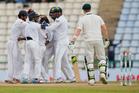 Sri Lankan team members celebrate the dismissal of Australia's Steve Smith. Photo / AP