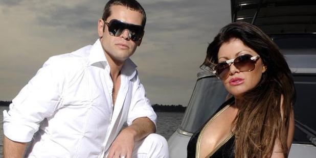 Zhenya and Lydia Tsvetnenko posing on a friend's boat. Photo / News Limited