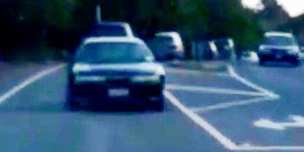 HAVE A CLOSER LOOK: The dark coloured car on the left-hand side of this photo is travelling backwards in a line of traffic travelling on Maunu Rd.