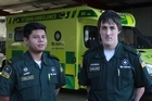St John Front line paramedics Jared Ranudo and Harrison Smythe talk about their lucky escape. They were hit by a speeding vehicle, which overturned their ambulance. After escaping from the wreckage, they attended to the person in the vehicle that crashed into them.