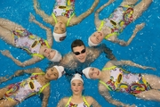 Herald reporter Ben Hill (centre) tried his best to keep up with the North Harbour Synchronised swimming 11-13 girls team at Glenfield Leisure Centre. Photo / Nick Reed