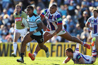 Ben Barba of the Sharks breaks the Knights defence. Photo / Getty
