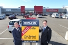Bayleys Hawke's Bay commercial manager Daniel Moffitt and broker Paul Garland outside The Warehouse, which their firm recently sold. Photo / Duncan Brown