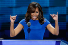 First Lady Michelle Obama waves to delegates during the first day of the Democratic National Convention in Philadelphia. Photo / AP