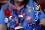 A delegate wears a hat with a bubble-head doll of Democratic Presidential candidate Sec. Hillary Clinton. Photo / AP