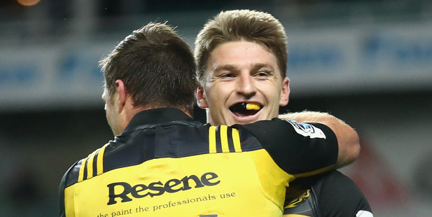 Cory Jane, left, has been Mr Invisible this season while the likes of Beauden Barrett, right, and Julian Savea have led the headlines. Photo / Getty