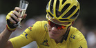 Britain's Chris Froome, wearing the overall leader's yellow jersey, celebrates with a glass of champagne. Photo / AP