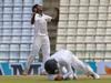 Sri Lanka's bowler Lakshan Sandakan celebrates as Kusal Mendis, foreground takes a catch to dismiss Australia's Steve O' Keefe. Photo / AP