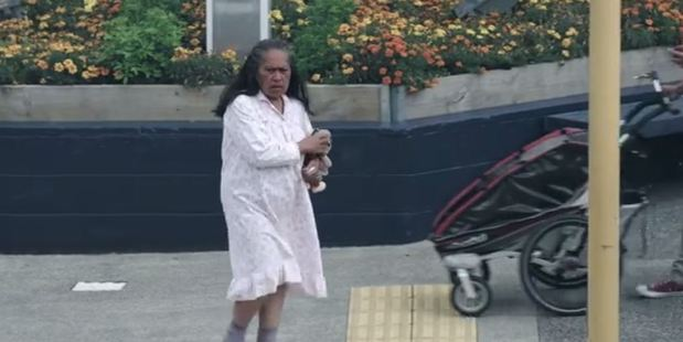 The distressed woman in the video is clutching a soft toy and wearing only a nightgown. Photo / via NZ Police