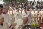 Watch: Pope Francis trips and falls during mass