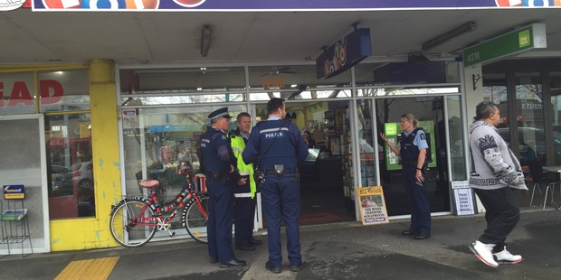 Police at the scene of Greerton Lotto on Cameron Rd, after an aggravated robbery there this morning. Photo/George Novak