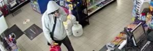 Armed robber strikes twice