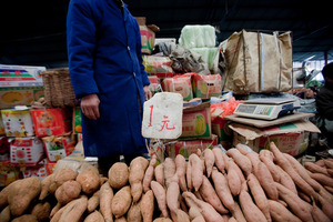 Sweet potatoes on sale at a Beijing market. Photo / Bloomberg