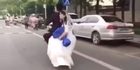 Watch: Watch: Groom doesn't notice when bride falls off scooter