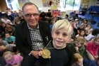 Gary Robertson took his 1972 gold medal to Kaimai School for the pupils to check out.