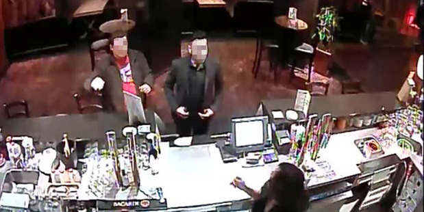 Loading CCTV security video still of two men at the Grasshopper Restaurant at the Stamford Hotel Albert St central Auckland who ordered food and drinks totaling $291.00 and left without paying.